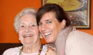 Woman with grandmother smiling