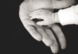 Baby and adult hands