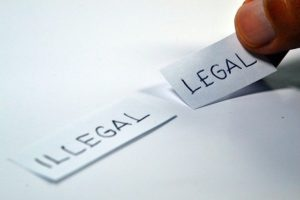 strips of paper with the words illegal and legal