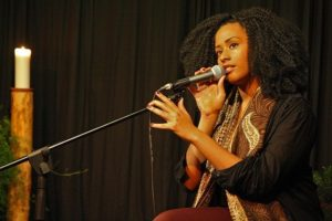 Singer with microphone and candle